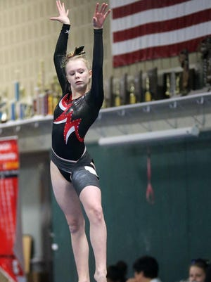 Canton returnee Jana Hilditch is one of the team's strong all-around performers back from last year's regional champs.