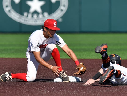 Sweetwater's Chris Thompson covers second base to tag out Burkburnett's Cole Schultz during Thursday's game at Abilene Christian University. This was Game 1 of  their first round series in the Class 4A state baseball playoffs