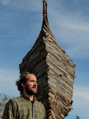 Detroit artist Scott Hocking stands near the front