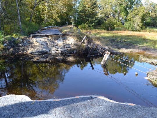 The dam at Barren Creek Pond and the road on top of it washed away in a severe storm in July 2016. Wicomico County officials are now looking at options for repairing it.