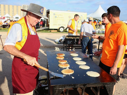 Volunteers flip pancakes for the pancake breakfast