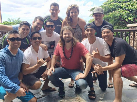 Gravity Payments CEO Dan Price with his Hawaii team.