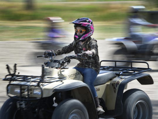 In this  July 11, 2015 photo, Taylee Barnes drives an ATV during a youth ATV safety course at the Weber County Fairgrounds in Ogden. State Parks officials say only 38 percent of younger riders obtain proper certification for using ATVs.