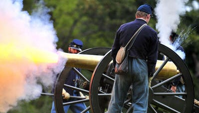 """Civil War re-enactors fire a 12-pound Napoleon cannon during """"Thunder on the Mountain"""" at South Mountain State Battlefield near Burkittsville, Md., on Aug. 19, 2012."""