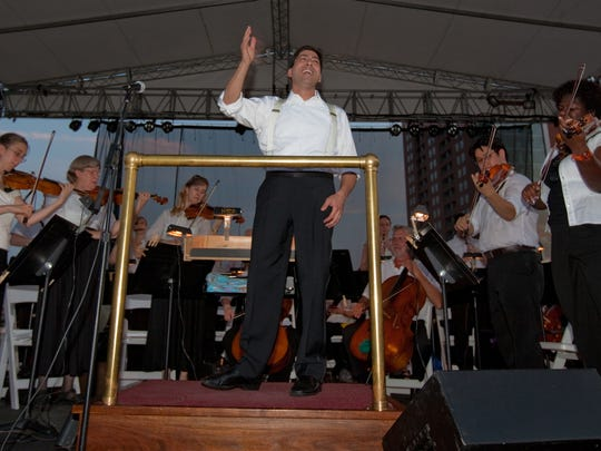 David Amado conducts the Delaware Symphony Orchestra as part of Wilmington's Fourth of July celebration in 2012. The symphony returns for this year's event on Wednesday, performing at 8 p.m. just before the city's fireworks show.