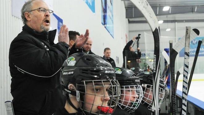 Bob Kravitz, goaltender coach for the Zionsville Arctic Eagles high school hockey team is seen as his team defeats the Penn Kingsman team 4-1 for the 3A state hockey championship in Ft. Wayne Saturday March 8, 2014.