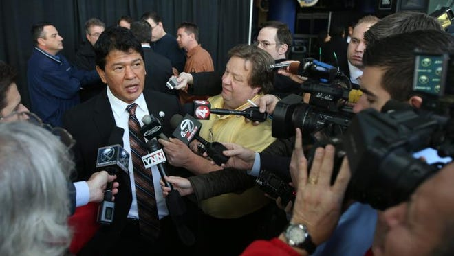 Ted Nolan, new head coach of the NHL hockey team Buffalo Sabres, is interviewed by the media following a press conference at First Niagara Center in Buffalo.