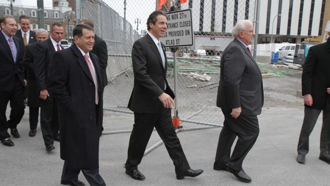Rochester Mayor Tom Richards leads Gov. Andrew Cuomo and a group of people with the Finger Lakes Regional Economic Development Council into the Midtown construction site in November 2012.