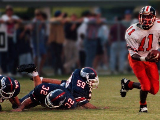 Shanks' quarterback Willie Simmons escapes the pocket during a game against Wakulla.