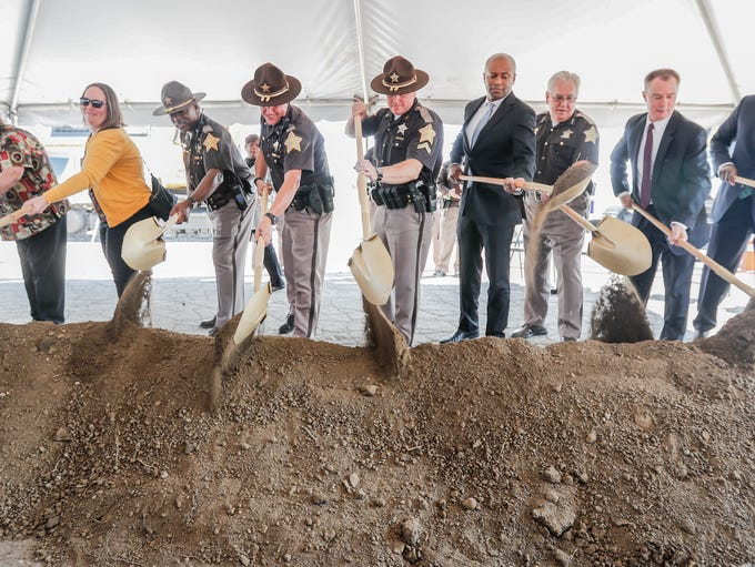 Community officials and leaders take scoops of dirt