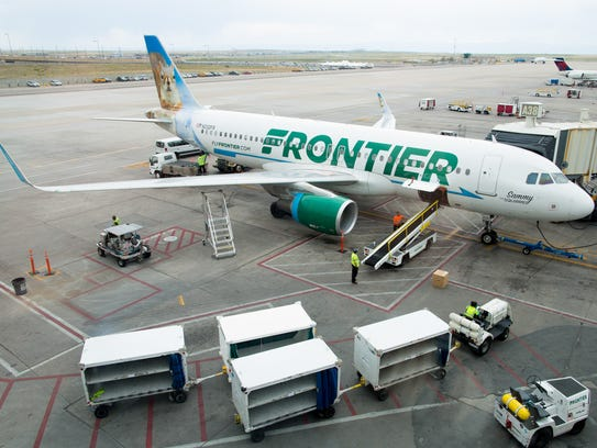A Frontier Airbus A320 is leaded for its next flight