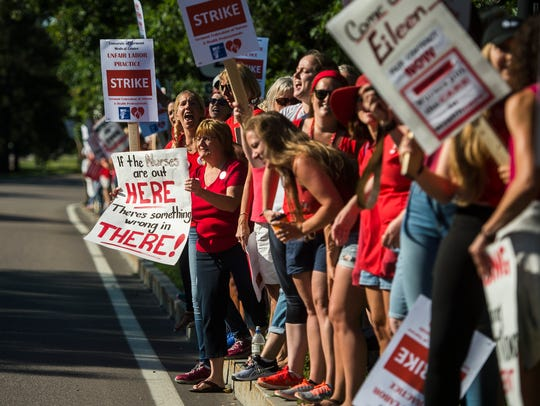 Nurses picket on East Avenue in Burlington near UVM