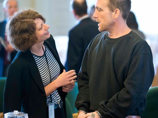 Chris Burnor (right) speaks to his lawyer, public defender Kelly Green, after being arraigned on first-degree murder and reckless endangerment charges in Vermont Superior Court in Hyde Park on Thursday, September 25, 2014.