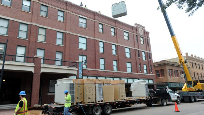 A crew from Batjer & Associates Mechanical Contractors delivers air-conditioning units to the roof of The Grace Museum on Thursday, Jan. 12, 2017. The left lane of Cypress Street temporarily was closed to accommodate the machinery.