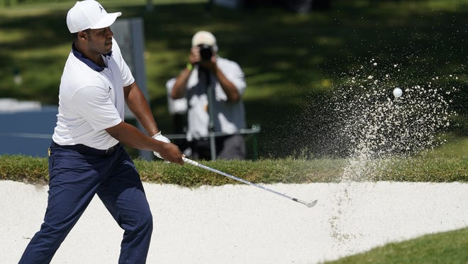 Harold Varner III hits out of the sand at the eighth green during the second round of the Charles Schwab Challenge golf tournament at the Colonial Country Club in Fort Worth, Texas on Friday.