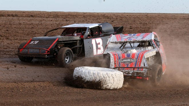 Corey Lane (13) and Gregory Gorham (73) jostle for position during Saturday night's limited modified action in the season opening night at Route 66 Motor Speedway.