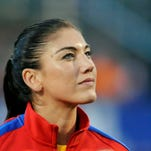 USA goalkeeper Hope Solo (1) stands for the playing of the national anthem at a game against Mexico at Sahlen's Stadium on Sept. 18.