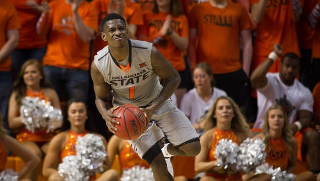Oklahoma State guard Jawun Evans looks to pass the ball against Kansas on March 4, 2017.