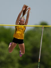 Green Bay Preble's Jensen Van Duyse clears the bar while competing in the Division 1 girls pole vault during the WIAA state track and field meet last year in La Crosse. Van Duyse placed fourth in her first state appearance and is hoping to return to state from a loaded sectional in the event.