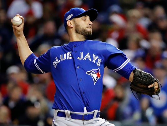 Toronto Blue Jays starting pitcher Marco Estrada throws to a Cleveland Indians batter during the second inning in Game 1 of baseball's American League Championship Series in Cleveland, Friday, Oct. 14, 2016. (AP Photo/Gene J. Puskar)