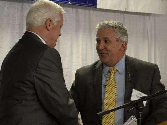 Sen. Mike Folmer shakes hands with Gov. Tom Corbett during an event that announced the new Sechler Family Cancer Center at the Good Samaritan Health System on May 29.