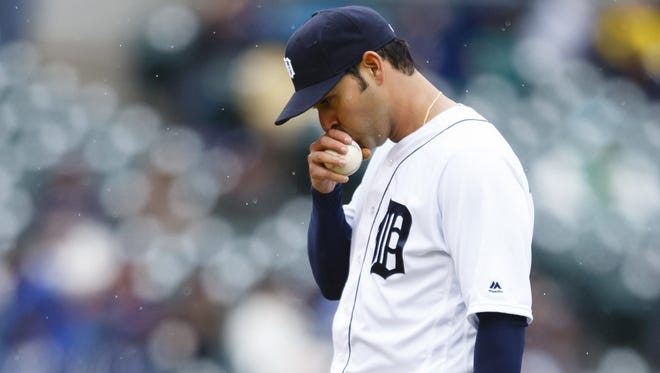 Apr 28, 2016; Detroit, MI, USA; Detroit Tigers starting pitcher Anibal Sanchez (19) kisses the ball during the third inning against the Oakland Athletics at Comerica Park.