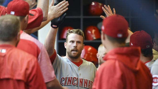 Zack Cozart is congratulated following his first-inning home run against the Brewers on Friday.