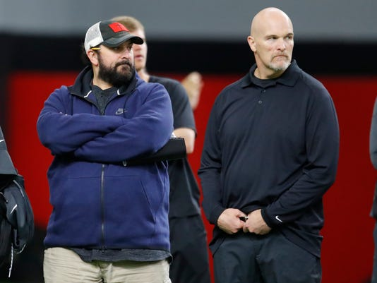 Detroit Lions head coach Matt Patricia, left, and Atlanta Falcons head coach Dan Quinn watch during Georgia Pro Day, Wednesday, March 21, 2018, in Athens. Pro Day is intended to showcase talent to NFL scouts for the upcoming draft. (AP Photo/Todd Kirkland)