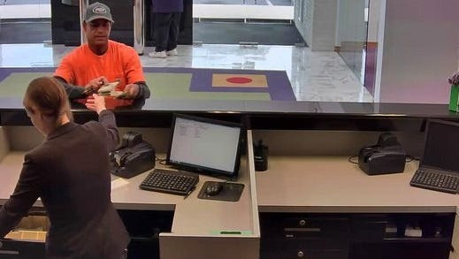 The suspect in a bank robbery at TD Bank in Monroe was seen on video footage.