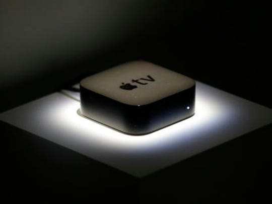 FILE - This Sept. 9, 2015, file photo shows the new Apple TV during a product display following an Apple event in San Francisco.  Your streaming TV options just got better and cheaper. Features that once required a $100 device can now be had for as little as $30. A cheap device is fine for getting TV shows and movies from most popular services onto a big-screen TV, as long as it's a regular, high-definition set.