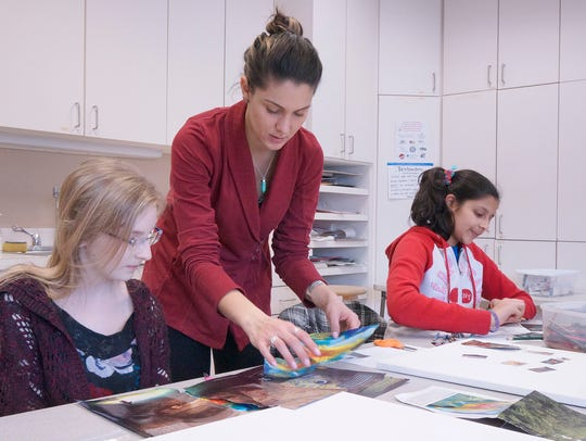 Instructor Christine Evans works with students Heather