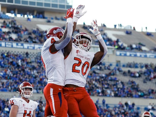Oct 12, 2019; Colorado Springs, CO, USA; Fresno State Bulldogs wide receiver Emoryie Edwards (4) celebrates his touchdown with running back Ronnie Rivers (20) in the first quarter against the Air Force Falcons at Falcon Stadium. Mandatory Credit: Isaiah J. Downing-USA TODAY Sports