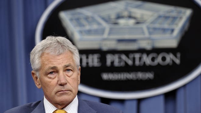 Defense Secretary Chuck Hagel listens during a news conference at the Pentagon, Wednesday, June 26, 2013. A memo written by Hagel obtained by The Associated Press suggests that unmarried same-sex couples may not receive the same benefits as married ones.