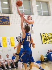 Forbes Road's Brycen Hohman (21) shoots a basket while