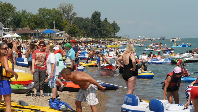 Participants gather at Port Huron's Lighthouse Beach to start their journey at the St. Clair River Float Down.