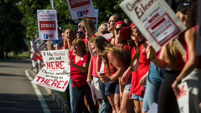 Nurses picket on East Avenue in Burlington near UVM Medical Center after hundreds walked out on strike Thursday morning, July 12, 2018. At odds over pay, staffing levels and other issues, the nurses union and the hospital administration have been unable to come to an contract agreement.