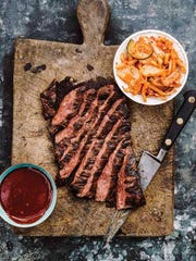 "Honey Soy Flank Steak from ""Korean BBQ"" sits in a flavorful"