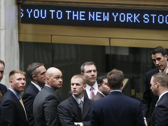 FILE - In this March 9, 2009, file photo, businessmen arrive at the New York Stock Exchange in New York. It was on March 9, 2009, that stocks finally hit bottom in the financial crisis, after the Standard & Poor's 500 index lost 55 percent in 17 months and gutted retirement and other investment accounts. The next day, the S&P 500 perked up by 6.4 percent, and it's been racing higher ever since thanks to extraordinary stimulus from the Federal Reserve and a recovery in corporate profits, with only a few interruptions in between. (AP Photo/Mark Lennihan, File)