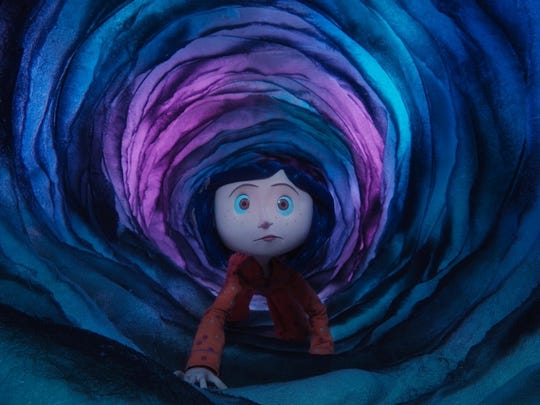 "An adventurous girl finds a portal in her house in ""Coraline"" (2009)."