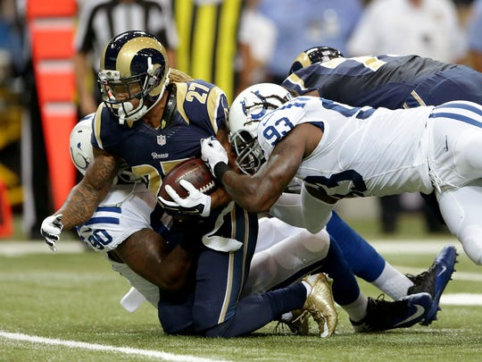 Indianapolis Colts outside linebacker Erik Walden (93) and  Kendall Langford (90) team up to tackle St. Louis Rams running back Tre Mason (27) in the first half of their game Saturday, August 29, 2015, at the Edward Jones Dome in St. Louis, MO.