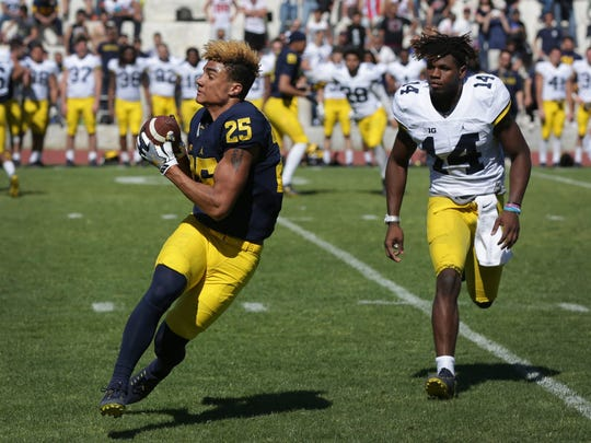 Michigan's Nate Johnson catches the ball against Josh