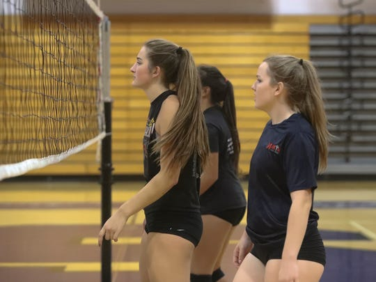 Shasta High School seniors Sophie Wood, left, and Cate Walton, right, line up during a school practice. Wood was named player of the year for the 2017 All-Northern Section volleyball team and Walton also made the first team as an all-around selection.