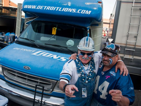 "Ron ""Crackman"" Crachiola, and Donnie ""Yooperman"" Stefanski, pose for a photo while tailgating at Eastern Market before the Lions' game against the Washington Redskins on Oct. 23, 2016."