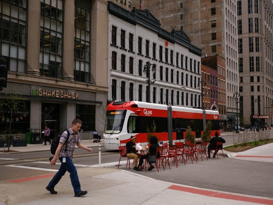 The QLINE moves in downtown Detroit on Woodward Avenue