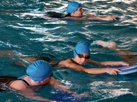 Matt Hollinshead — Current-Argus The Carlsbad swim camp works on kick drills Wednesday. The five-day camp will conclude at noon today.