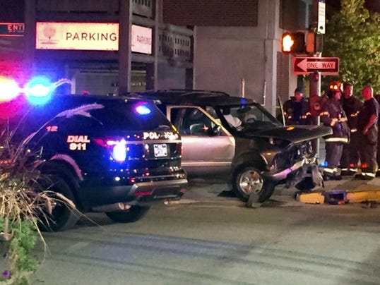 York City Police and fire crews investigate a two-vehicle crash at North Beaver and West Philadelphia streets on Sept. 15. Police charged a York man in connection with the crash that left one woman with a brain injury.