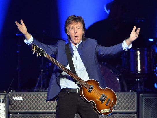 Paul McCartney greets the crowd at the start of his
