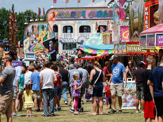 Young and old alike enjoy the carnival midway at the
