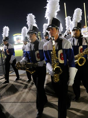 Members of the Cooper High School Awesome Cooper Band exit the field after their performance in the Big Country Marching Festival on  Oct. 16. Twenty-one bands competed at Wylie High School.