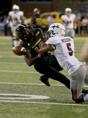 Southern Miss Golden Eagles wide receiver Korey Robertson (18) has a pass defended by UTEP Miners defensive back Nik Needham (5) in the first half at M. M. Roberts Stadium. Mandatory Credit: Chuck Cook-USA TODAY Sports